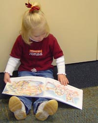 A little girl reading
